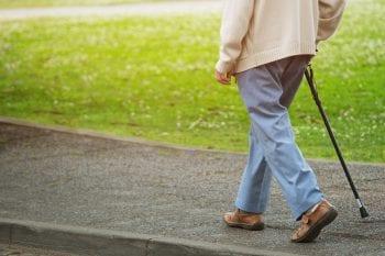Elderly,Old,Man,With,Walking,Stick,Stand,On,Footpath,Sidewalk